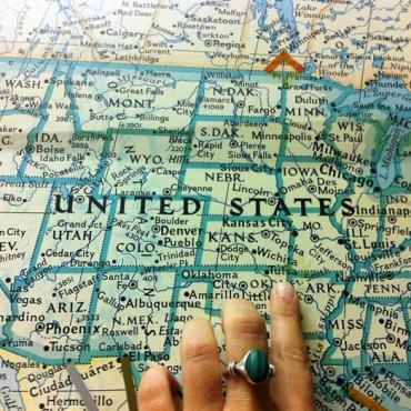 Map of USA pointing finger.jpg