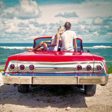 istock couple sitting on car.jpg