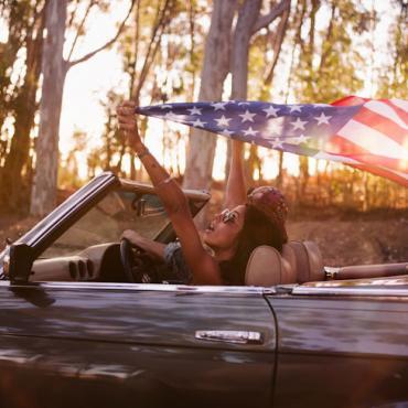 Car couple flying flag