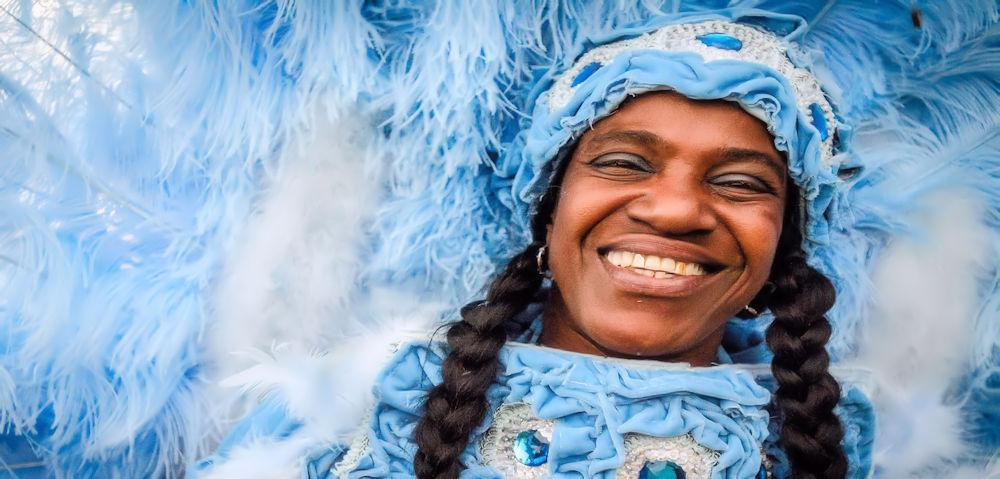 Main Page MSY Mardi Gras blue costume by Pableaux Johnson Photo Courtesy of New Orleans CVB