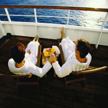 Breakfast couple on balcony cruise