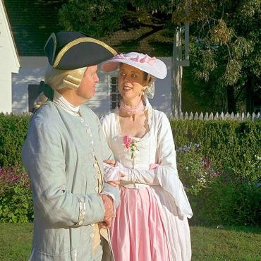 Couple in garden Colonial WIlliamsburg VA