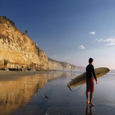 CA bro surfer on beach
