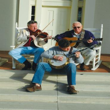 3 musicians playing instruments