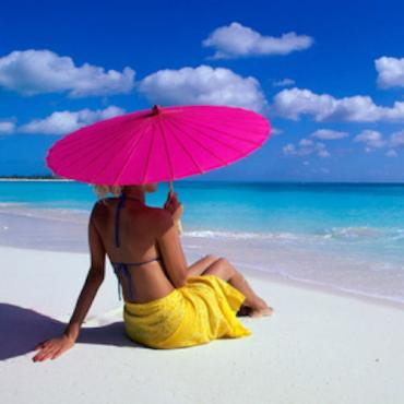 beach lady with pink brolly.jpg