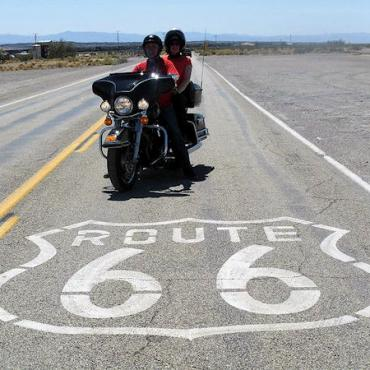 ERIder Rte 66 sign on road & bike.jpg