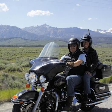 ERider couple on bike.jpg